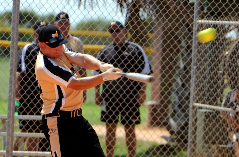 Sgt. 1st Class Clayton Shaw of Fort Campbell, Ky., hits a solo homer to get All-Army headed to a 3-0 victory over All-Navy in their final game of the 2010 Armed Forces Softball Championships Sept. 23 at Naval Air Station Pensacola, Fla. U.S. Army photo by Tim Hipps, FMWRC Public Affairs